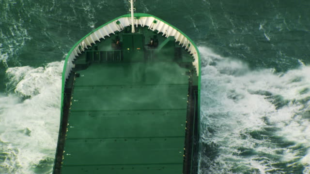 France, Bretagne: Cargo boat cleaving through waves