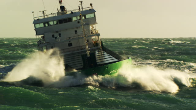 France, Bretagne: Cargo boat cleaving through waves