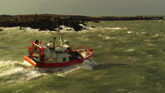 france, bretagne: little fishing boat cleaving through waves - atlantic ocean stock videos & royalty-free footage