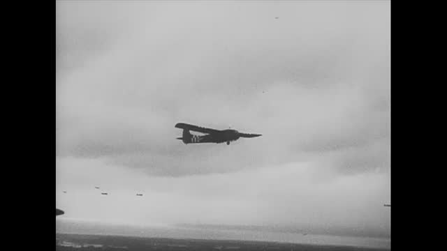 france, circa june 6, 1944: during the normandy attack, the second wave of gliders is launched. one glider lands on a flooded field. the clip shows... - gliding stock videos & royalty-free footage