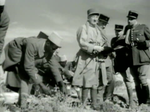 france colonized senegalese soldiers digging ditch vs french officer looking at plans ws france military encampment tents ws stacked oil drums vs... - ドラム容器点の映像素材/bロール