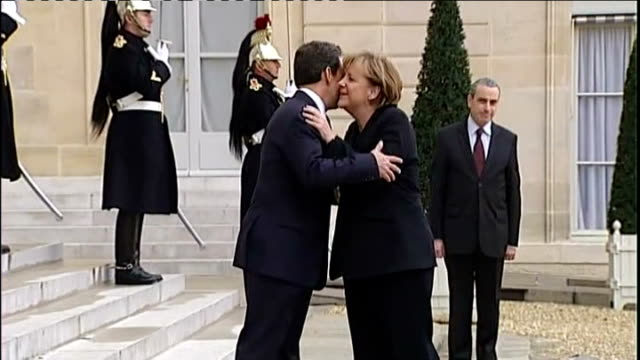 France faces credit downgrade as EU battles new crisis T05121101 Paris DAY German Chancellor Angela Merkel greeted by President Nicolas Sarkozy
