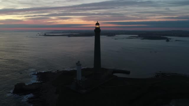 france from the sky : the highest lighthouse in europe : l'île vierge - lighthouse stock videos & royalty-free footage