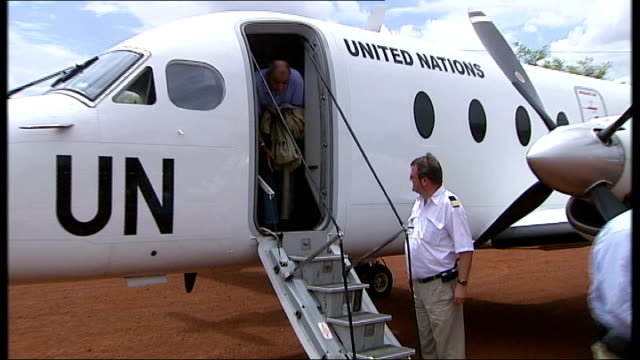 france hosts talks to help darfur; int pregnant woman with malaria laying sick on bed and husband looking on ext un team workers along from aircraft... - animale microscopico video stock e b–roll