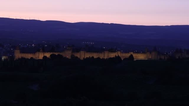 france, medieval city of carcassonne at the time of sunset with illuminated ramparts - aude stock videos & royalty-free footage