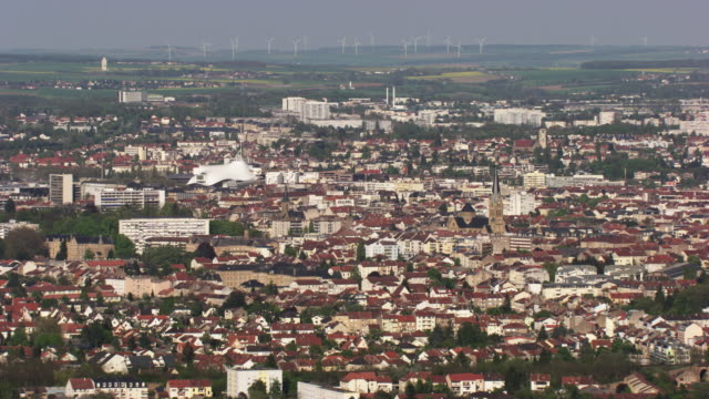 france, metz lorraine: aerial view of metz with wind turbines in the background - metz stock videos & royalty-free footage
