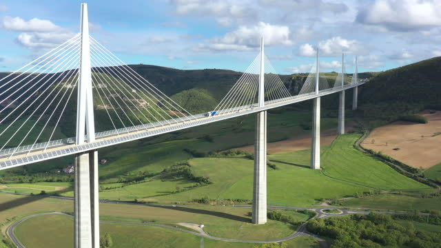 france, millau viaduct in the gorge valley of the tarn, drone aerial view. - helicopter point of view stock videos & royalty-free footage