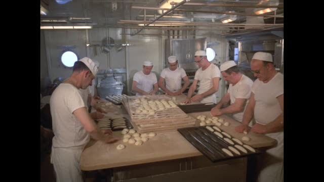 1968 - SS France ocean liner - bakers rolling dough in ship's kitchen