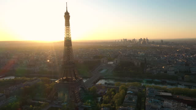 france, paris cityscape with river seine and eiffel tower, drone aerial view during sunset - place charles de gaulle paris stock videos & royalty-free footage