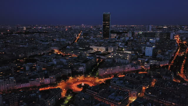 france, paris montparnasse tower at night drone view - place charles de gaulle paris stock videos & royalty-free footage