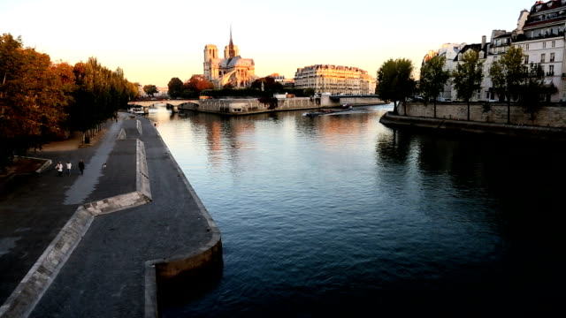 france paris river seine notre dame church cathedral sunrise - river seine stock videos & royalty-free footage