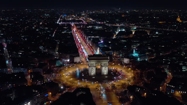 france, paris triumphal arch at night in champs elysees, drone aerial view - avenue des champs elysees stock videos & royalty-free footage