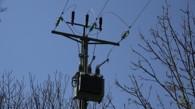 france power lines and blue sky - transformer stock videos & royalty-free footage