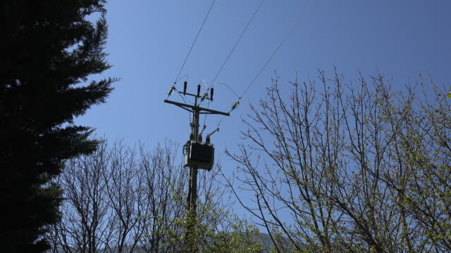 france power transmission lines zooms in - transformer stock videos & royalty-free footage