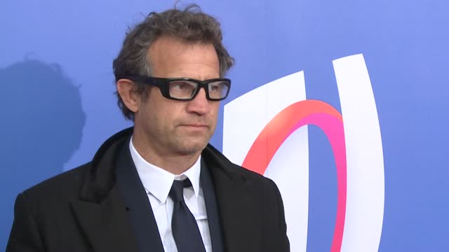 france rugby coach fabien galthie, designer christian louboutin and lyon player josua tuisova arrive for the 2023 rugby world cup draw at the palais... - le bourse quarter stock videos & royalty-free footage