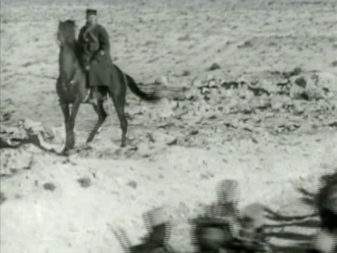 france trained senegalese soldiers walking w/ shovels on road. soldiers walking pass horse mounted officer. tanks on field, tunisian arab women... - senegal stock videos & royalty-free footage