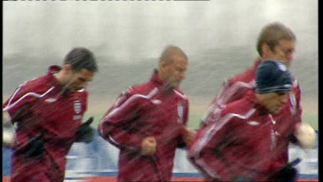 Rio Ferdinand to captain England LIB ENGLAND Hertfordshire London Colney England footballers jogging in warmup including Beckham and Paul Robinson