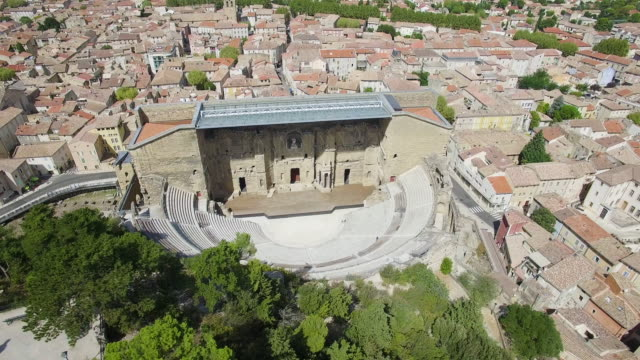 france, vaucluse, aerial view of antique theater of orange, 4k, uhd (3840x2160) - amphitheatre stock videos & royalty-free footage