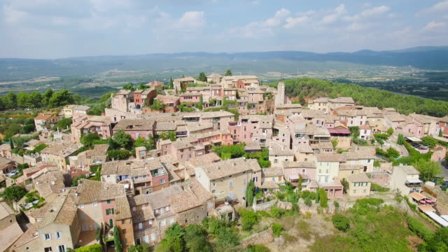 france, vaucluse, aerial view of roussillon, parc naturel regional du luberon - luberon stock videos & royalty-free footage