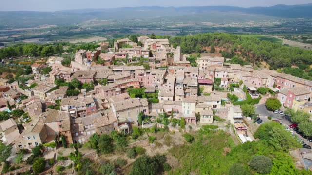 france, vaucluse, aerial view of roussillon, parc naturel regional du luberon - luberon video stock e b–roll