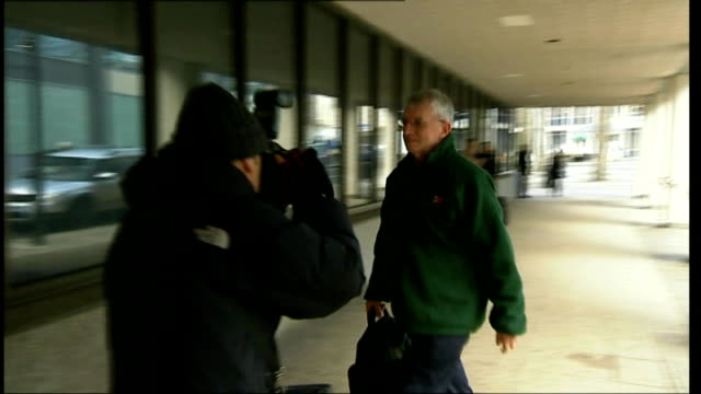 Violinst let down by mental health workers ENGLAND Manchester Manchester Crown Court SLOW MOTION shot Michael Brewer arriving at court for his trial...