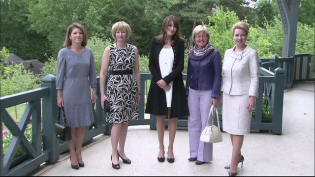 france's first lady carla bruni visibly pregnant welcomed wives of g8 leaders to a working lunch on the sidelines of the group's summit thursday... - g8 summit stock videos & royalty-free footage