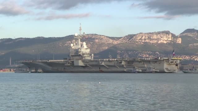 France's government launchs plans for a new aircraft carrier saying it will make a decision on how to build the multi billion euro warship in 2020