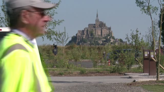 france's iconic montsaintmichel has long been a highlight for tourists montsaintmichel france - la manche stock videos and b-roll footage