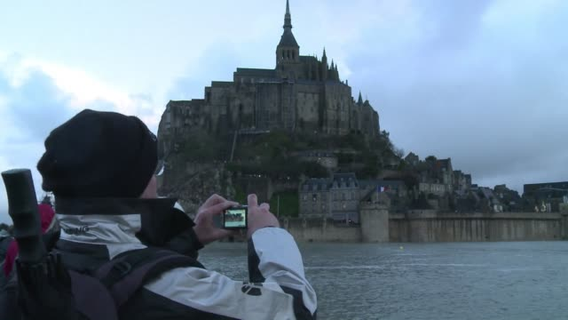 frances mont saint michel has become an island following an ususually high tide which has raised fears of flooding - la manche stock videos and b-roll footage