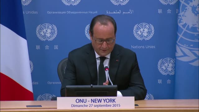 france's president francois hollande speaks at a press conference on the sidelines of the sustainable development summit which is taking place for... - 国際連合点の映像素材/bロール