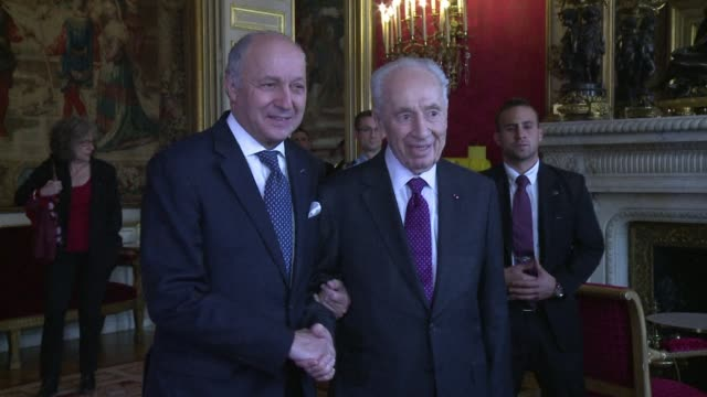 frances top diplomat laurent fabius receives former israeli president shimon peres as tensions rises over a draft un resolution on israels withdrawal... - east jerusalem stock videos & royalty-free footage