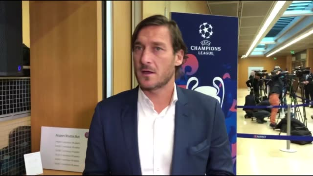 francesco totti, esteban cambiasso, florent malouda and pavel nedved arrive for the uefa champions league draw for the round of 16 at the uefa... - international team soccer stock videos & royalty-free footage