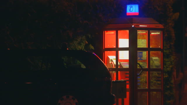 francetelephone booth at night - telefonzelle stock-videos und b-roll-filmmaterial
