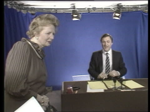 franchises; itn lib england: london: itn superchannel studio cms pm margaret thatcher peering into autocue pull out as newsreader john suchet reading... - teleprompter stock videos & royalty-free footage