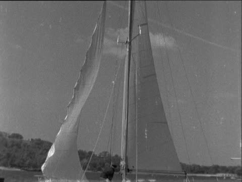 francis chichester sails for new york england plymouth yacht toward and along sails hoisted pan up yacht along ms chichestor on boat waves and fixes... - francis chichester stock videos & royalty-free footage