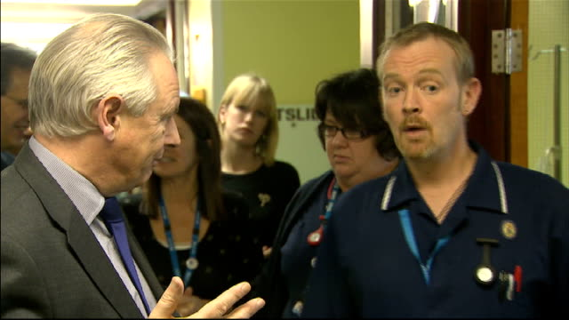 francis maude visits clacton hospital in essex england essex clacton int francis maude mp along hospital corridor as chats to staff member / maude... - patientin stock-videos und b-roll-filmmaterial
