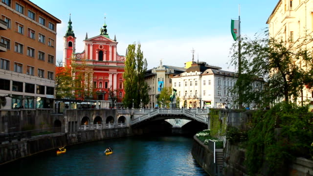 franciscan cathedral and bridge over ljubljanica river - cathedral stock videos & royalty-free footage