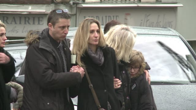 stockvideo's en b-roll-footage met franck brinsolaro the policeman who was killed in the charlie hebdo attack while on protection duty for cartoonist charb has been laid to rest in... - cartoonist