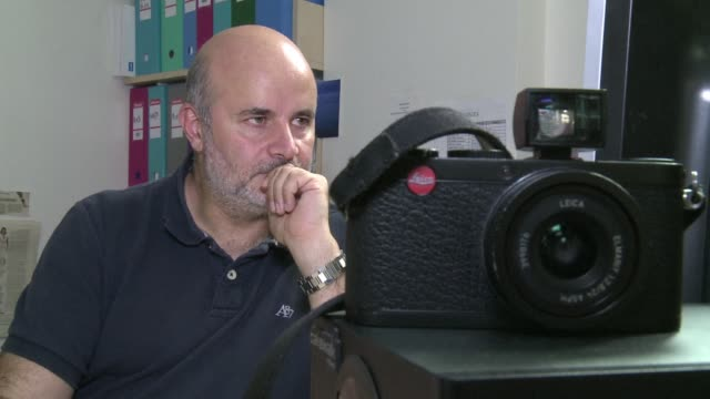 franco syrian photojournalist ammar abd rabbo talks about the constant terror of the bombings and the risks journalists take in covering the syrian... - photojournalist stock videos & royalty-free footage