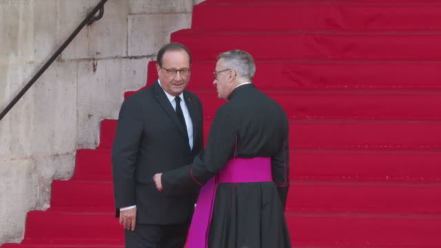 francois hollande arrives to attend a church service for former french president jacques chirac at the saint-sulpice church in paris on september 30,... - françois hollande stock videos & royalty-free footage