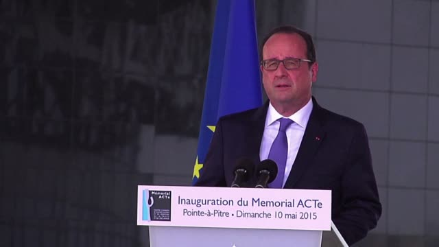 stockvideo's en b-roll-footage met francois hollande gave a speech in front of a memorial in guadeloupe commemorating the role of france in the slave trade that brought many to this... - franse overzeese gebieden