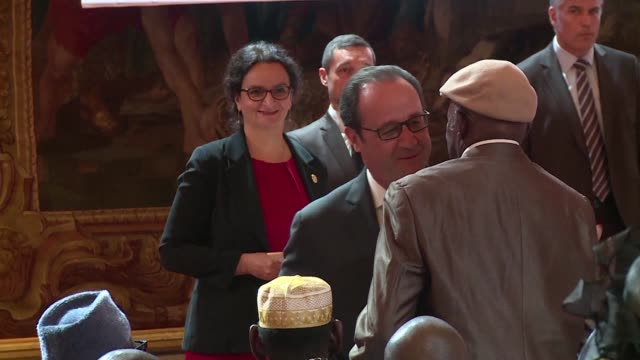 francois hollande leads a ceremony restoring french nationality for 28 former senegalese tirailleurs a corps of colonial infantry in the french army - esercito militare francese video stock e b–roll