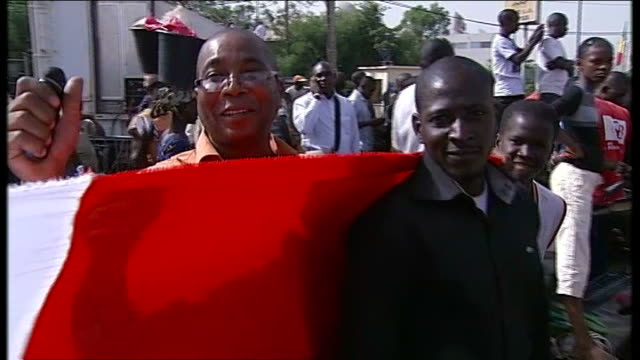 francois hollande receives hero's welcome in timbuktu; men gathered men cheering man saying 'vive la france' in front of man holding french flag sot... - françois hollande stock videos & royalty-free footage