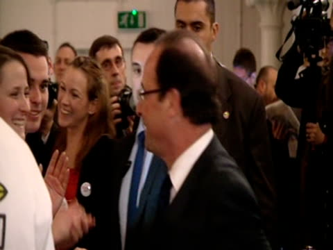 francois hollande, the socialist candidate for the french presidential election in 2012, with supporters during his campaign in london - キングスカレッジ点の映像素材/bロール