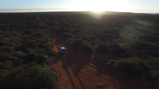 francois peron national park, western australia. aerial view of car off road at sunset - aerial stock videos & royalty-free footage