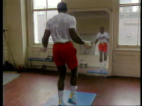 frank bruno comeback ms bruno sparring with unidentified fighter ms ditto bruno hitting punchbag bv bruno skipping cms frank bruno interview sof... - lying on back stock videos & royalty-free footage