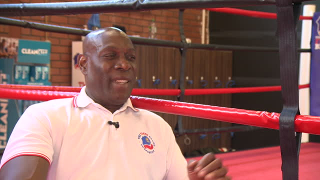 frank bruno laughing at art work of himself at one of his frank bruno foundation community centres, northampton - northampton stock-videos und b-roll-filmmaterial