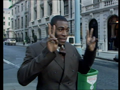 frank bruno prepares to fight mike tyson for world heavyweight title england london mayfair frank bruno standing in street with fists raised zoom in... - mike tyson boxer stock videos and b-roll footage