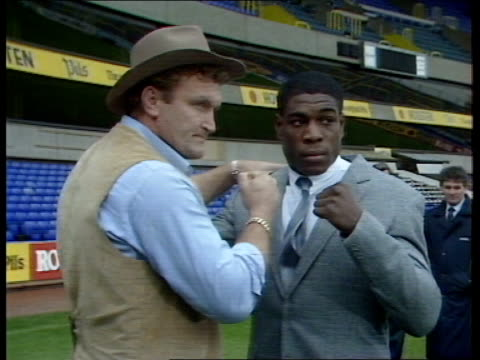 press conference and photocall england london white hart lane ext various shots of frank bruno and joe bugner photocall on white hart lane pitch... - itv lunchtime news stock videos and b-roll footage
