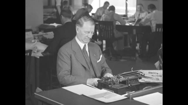 cu frank knox republican nominee for vice president smokes pipe / knox pipe in mouth types on typewriter in chicago daily news newsroom he is... - folded paper stock videos and b-roll footage